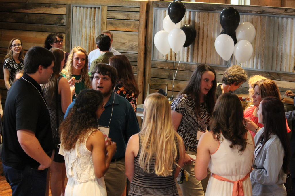 Recipients selected from the last four years mingle at the Cailloux Foundation Scholarship Banquet in May 2015.